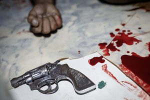 epa05422117 A revolver gun is seen next to a body of an alleged drug pusher and user who was killed in an operation of the police in Manila, Philippines, 12 July 2016. The number of traffickers killed in the Philippines since President Rodrigo Duterte won the elections has increased by more than 200 percent, according to police data. Photo by Mark Cristino/EPA