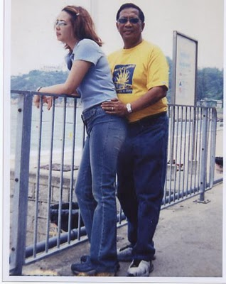 A Couple at the Penthouse of Makati City Hall, Enjoying the View