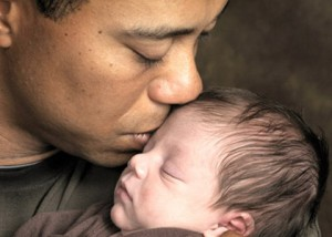 ORLANDO, FL - FEBRUARY 17: In this handout from the Tiger Woods family, (L-R) Tiger Woods kisses his son Charlie in a family photo taken on February 17, 2009 in Orlando, Florida. Charlie Woods was born on February 8, 2009. (Photo by Dom Furore/Woods Family via Getty Images) ëThe Woods family has requested that media using these images for publication can if possible make a donation to the Tiger Woods Foundation (www.tigerwoodsfoundation.org)í.